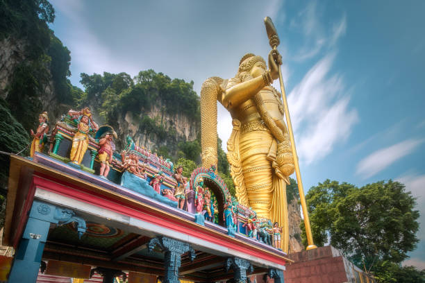 Statue of hindu god Muragan at Batu caves The Batu Caves and temple with statue of hindu god Murugan at entrance near Kuala Lumpur Malaysia kuala lumpur batu caves stock pictures, royalty-free photos & images