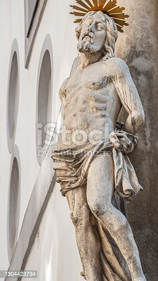 istock Statue of Jesus at the main facade of St. Peter's Catholic Church in Vienna downtown, Austria, details, closeup 1304423734