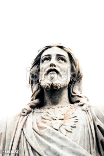 Closeup old marble statue of Jesus Christ looking up against white background from cemetery 1877, Sydney Australia, full frame vertical composition with copy space