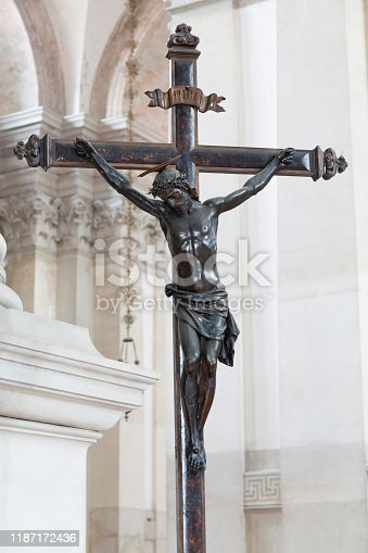 Statue of Jesus Christ on a cross inside a church, depicting the crucifixion
