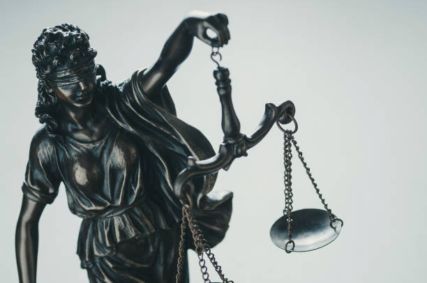 Statue of Justice holding aloft scales stock photo