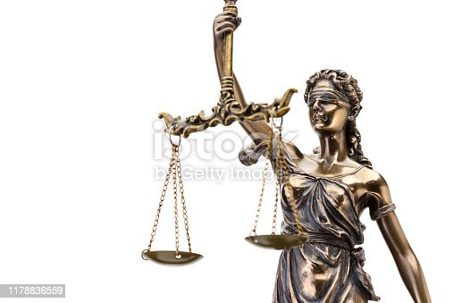 istock Statue of justice isolated on white background 1178836559
