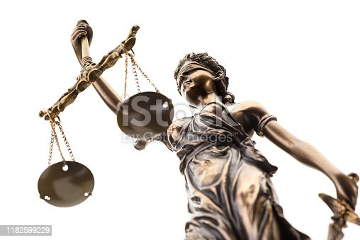 istock Statue of justice isolated on white background 1182599229