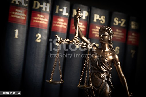 istock Statue of justice on books background 1084198134