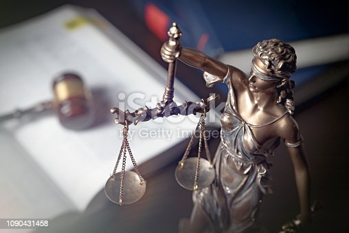 istock Statue of justice on books background 1090431458