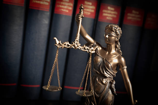 Statue of justice on books background Lady justice, themis, statue of justice on books background. Law concept with justice figurine in library criminal stock pictures, royalty-free photos & images