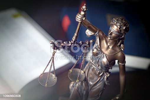 istock Statue of justice on books background 1096860308