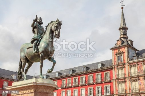 Casa de la Panadería in Plaza Mayor, Madrid, Spain with the bronze statue of King Philip III on the horse in front,  on the square Plaza Mayor from 1616