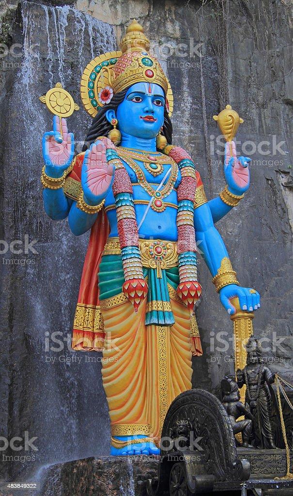 statue of Krishna nearly Batu caves stock photo