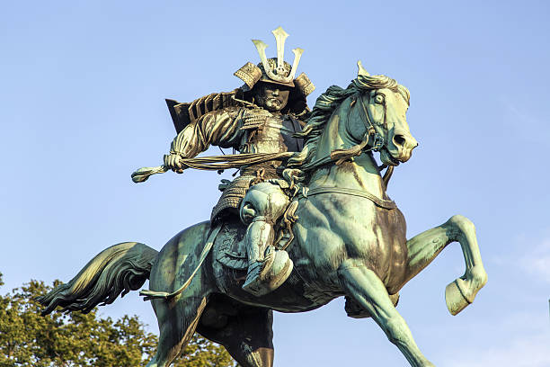 statue of kusunogi masashige in tokyo - knight on horse stock photos and pictures