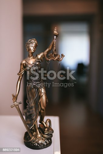 istock Statue of Lady Justice in an lawyer office 889201594