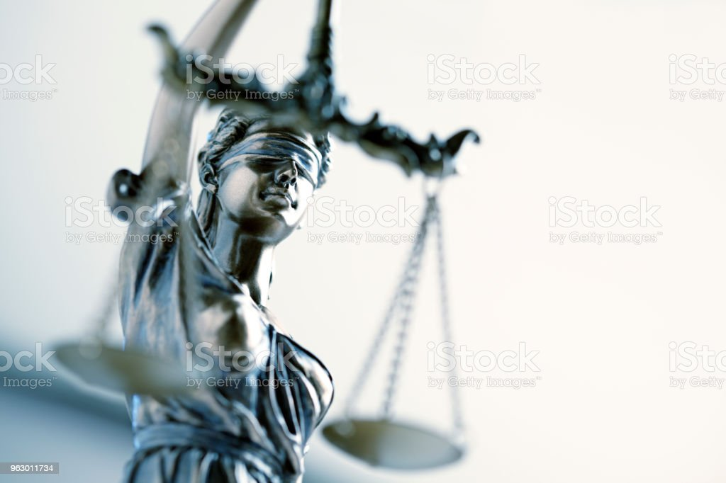 Statue Of Lady Justice In Front Light Colored Background stock photo