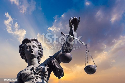 istock Statue of Lady Justice in front of the Romer in Frankfurt - Germany 1165653526