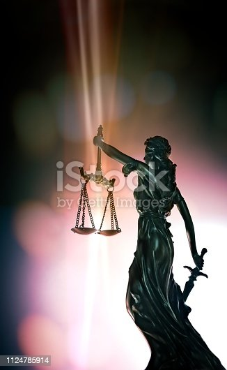 istock Statue Of Lady Justice - low angle view with bokeh background. 1124785914