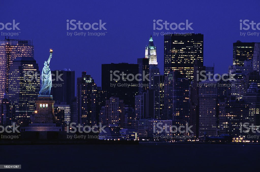 Statue of Liberty against the New York skyline, USA royalty-free stock photo
