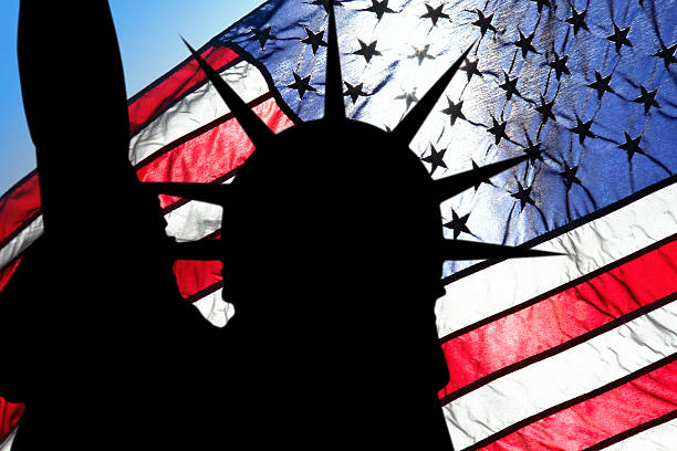 statue of liberty and american flag - emigration and immigration stock photos and pictures