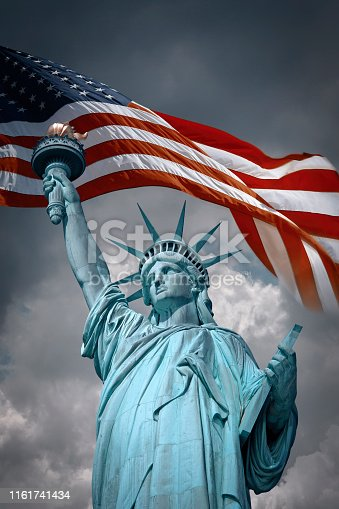 American symbols: Statue of Liberty and waving flag of USA