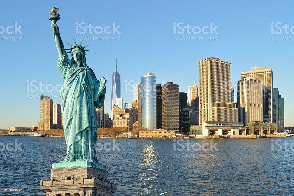 Statue of Liberty and Manhattah skyline. stock photo