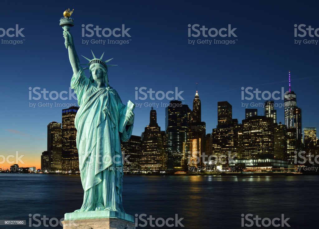 Statue of Liberty and Manhattah skyline. stock photo