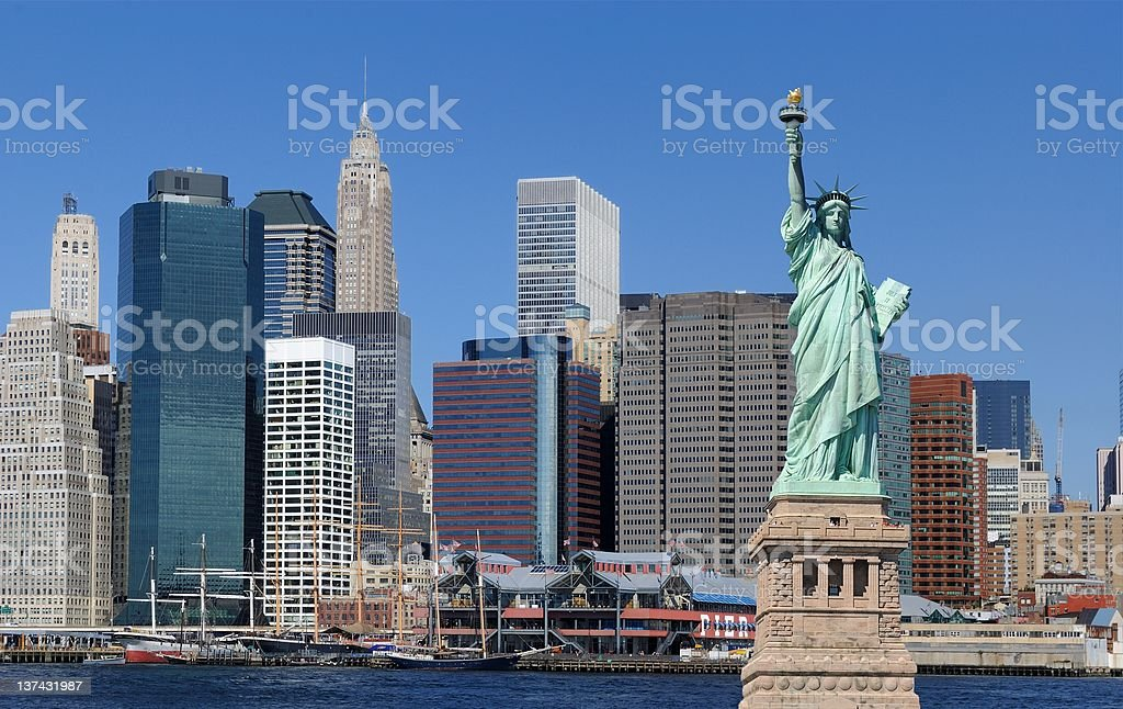 Statue of Liberty and New York City royalty-free stock photo