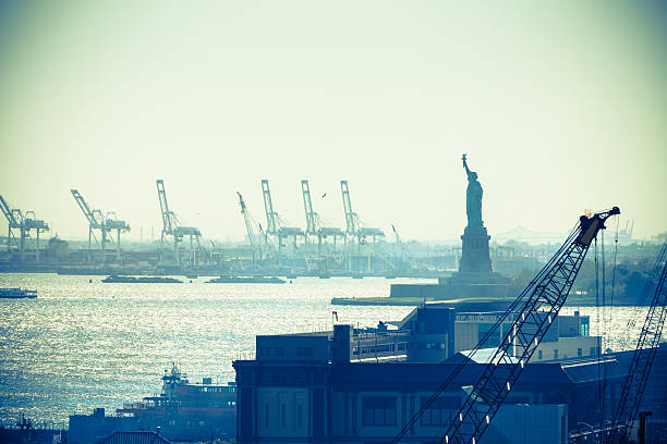 Statue of liberty and New York City port stock photo