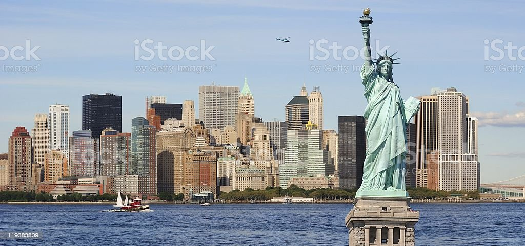 Statue of Liberty and New York City Skyline stock photo