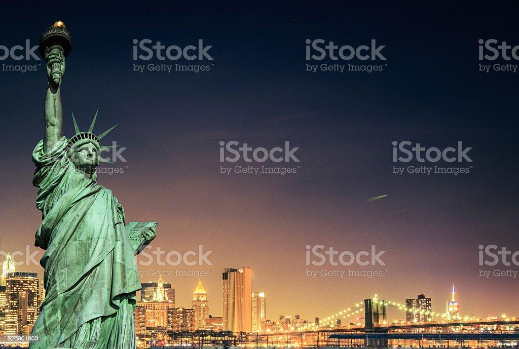 Statue of Liberty and New York City skyline stock photo