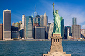 Statue of liberty and New York City Skyline with Financial District of Manhattan Lower East Side, World Trade Center, FDR Drive, Beekman tower and East River, NY, USA.