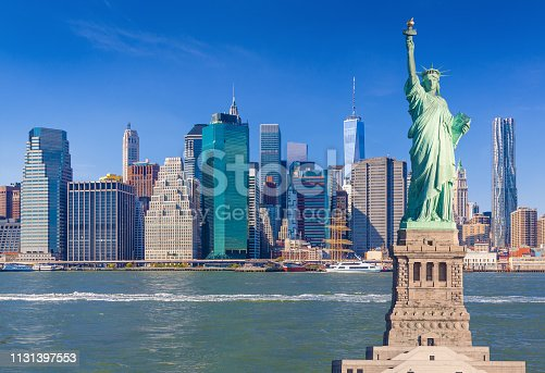 Statue of Liberty and New York City Skyline with Manhattan Lower East Side, World Trade Center, Beekman Tower (New York by Gehry), Woolworth Building, FDR Drive and East River, NY, USA.