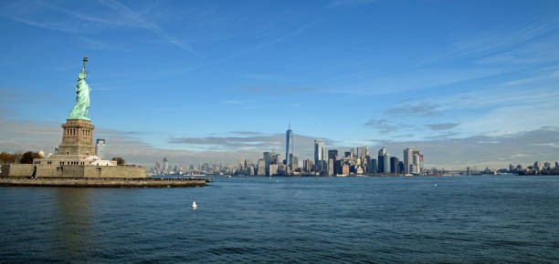 Statue of Liberty and NYC skyline stock photo