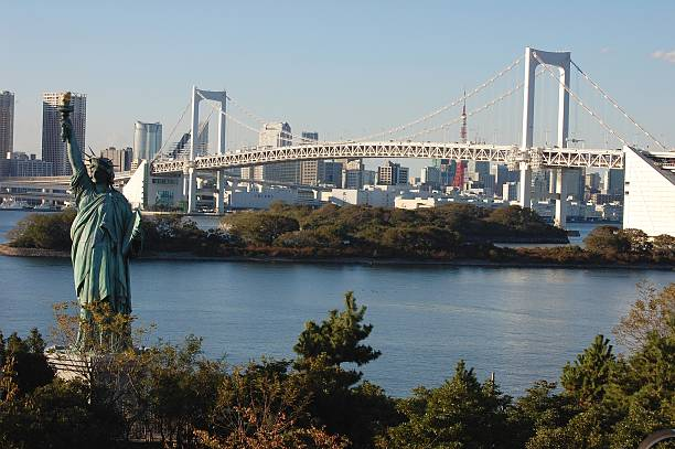 Statue of Liberty and Rainbow bridge from Odaiba, Tokyo stock photo