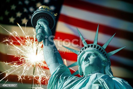 182764873istockphoto Statue of Liberty and sparkler on American flag 496263807