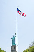 Statue of Liberty and USA flag, New York City, USA