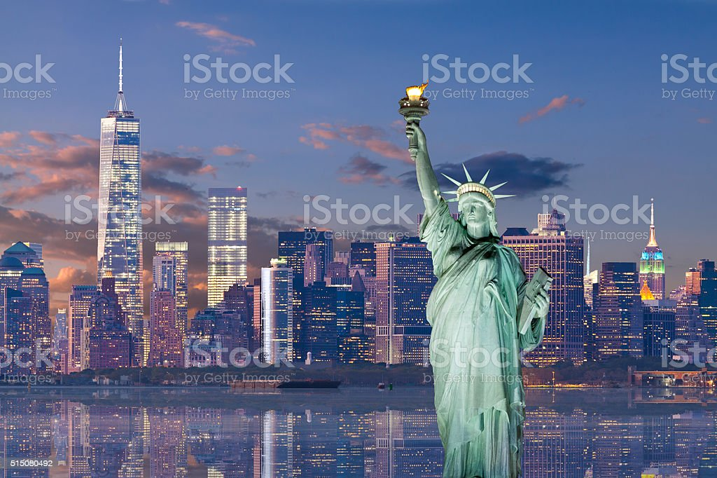 Statue of Liberty and World Trade Center at sunset, NYC. stock photo