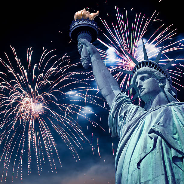 Statue of Liberty at night with fireworks, New York, USA stock photo