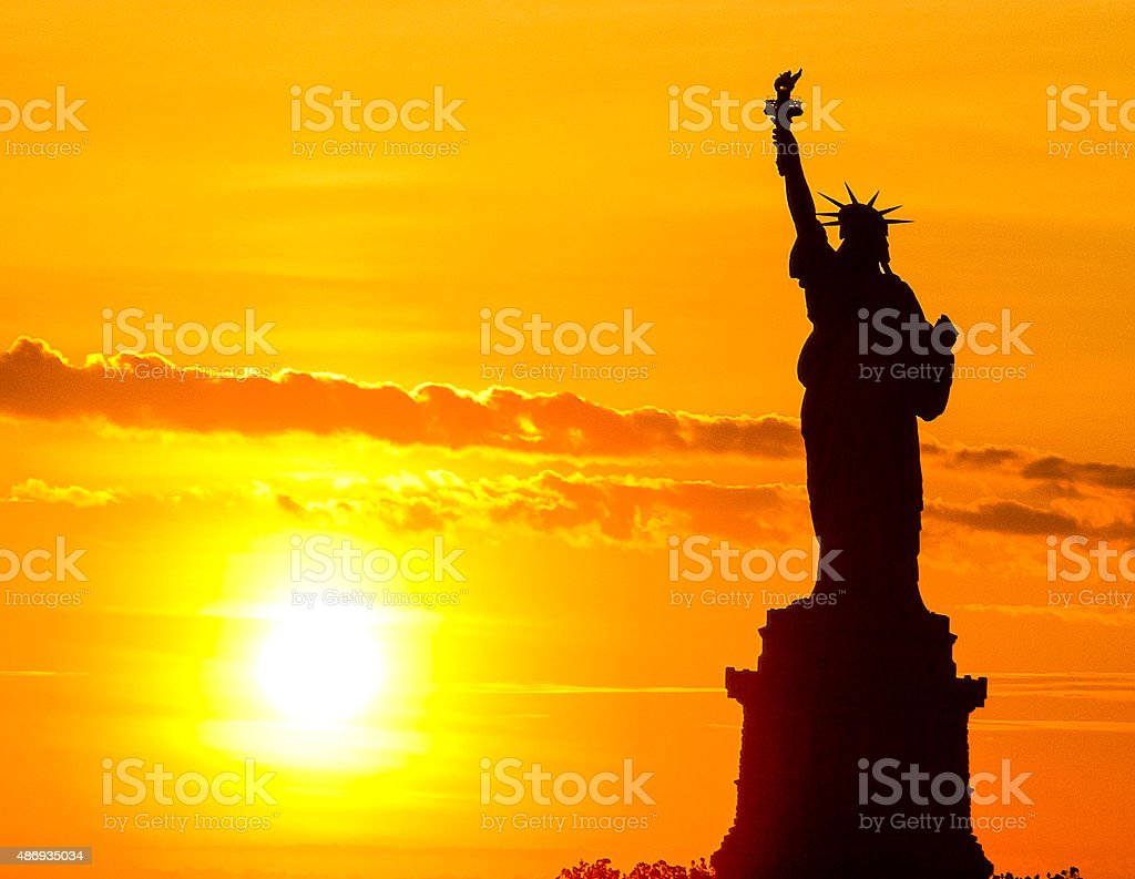 Statue of Liberty at sun set stock photo