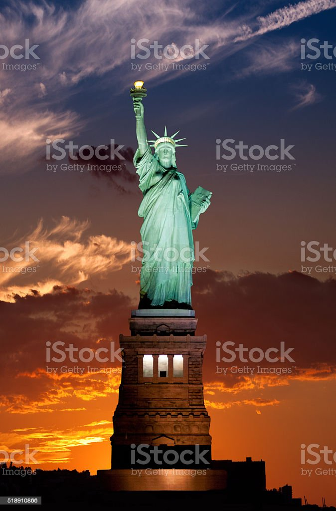 Statue of Liberty at sunset, blue and red sky, NYC. stock photo