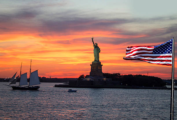 Statue of Liberty at sunset. stock photo