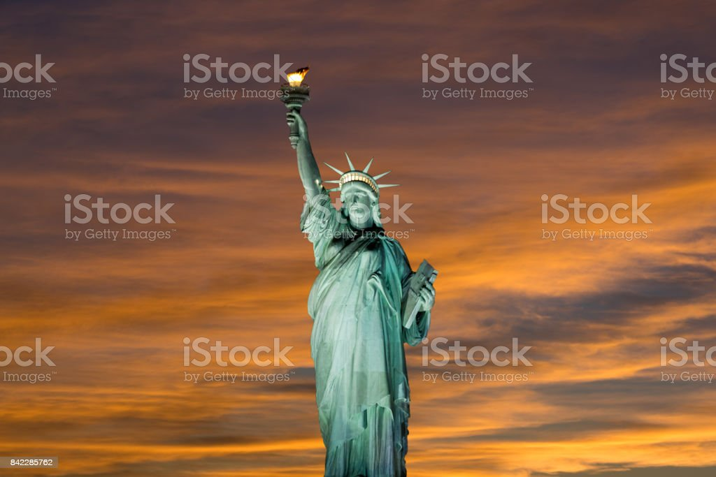 Statue of Liberty at Sunset with Blue and Amber Sky, New York City. stock photo