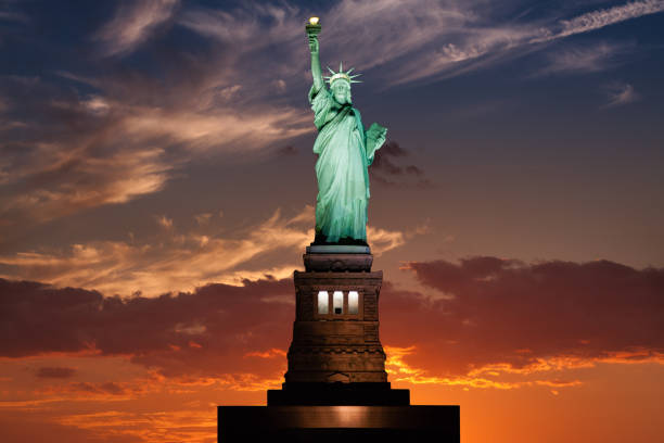 Statue of Liberty at Sunset with Blue and Red Sky, New York City. stock photo