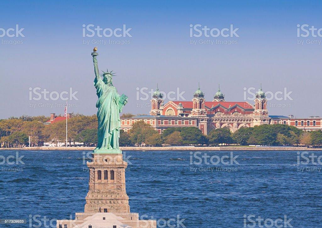 Statue of Liberty, Ellis Island, New York. Morning blue sky. stock photo