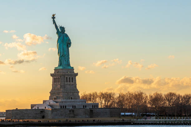 Statue of liberty horizontal during sunset in New York City, NY, USA Statue of liberty horizontal during sunset in New York City, NY, USA liberty island stock pictures, royalty-free photos & images