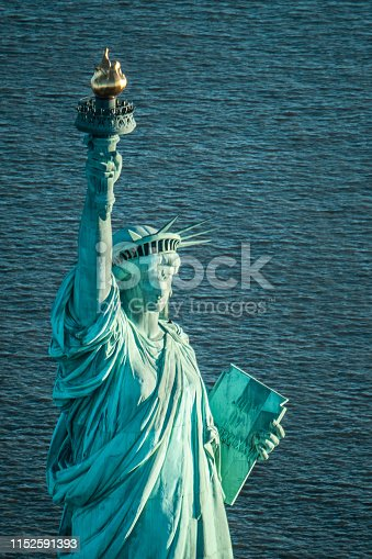 Lady Liberty shining her torch, captured by air.