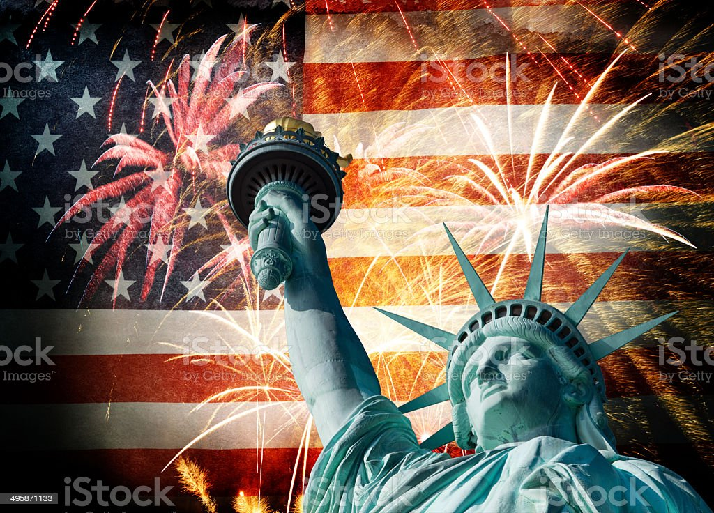 Statue Of Liberty Infront Of American Flag With Fireworks stock photo