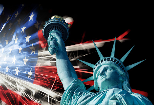 182764873 istock photo Statue Of Liberty Infront Of Sparkling American Flag 496446393