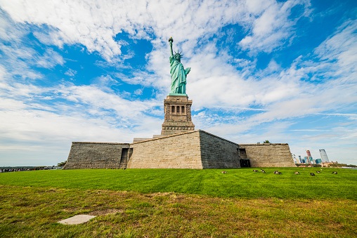 Statue of Liberty National Monument with blue sky background. New York, USA.