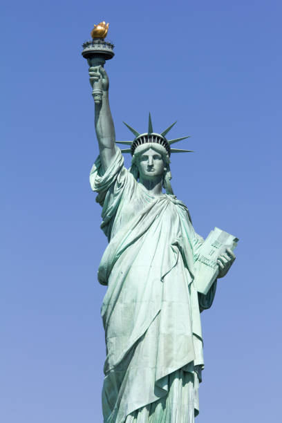 Statue of Liberty Statue of Liberty in front of blue sky liberty island stock pictures, royalty-free photos & images