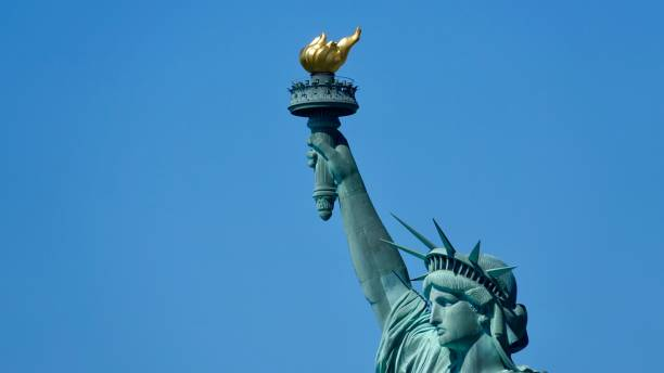 Statue of Liberty focus on head and torch flaming torch stock pictures, royalty-free photos & images