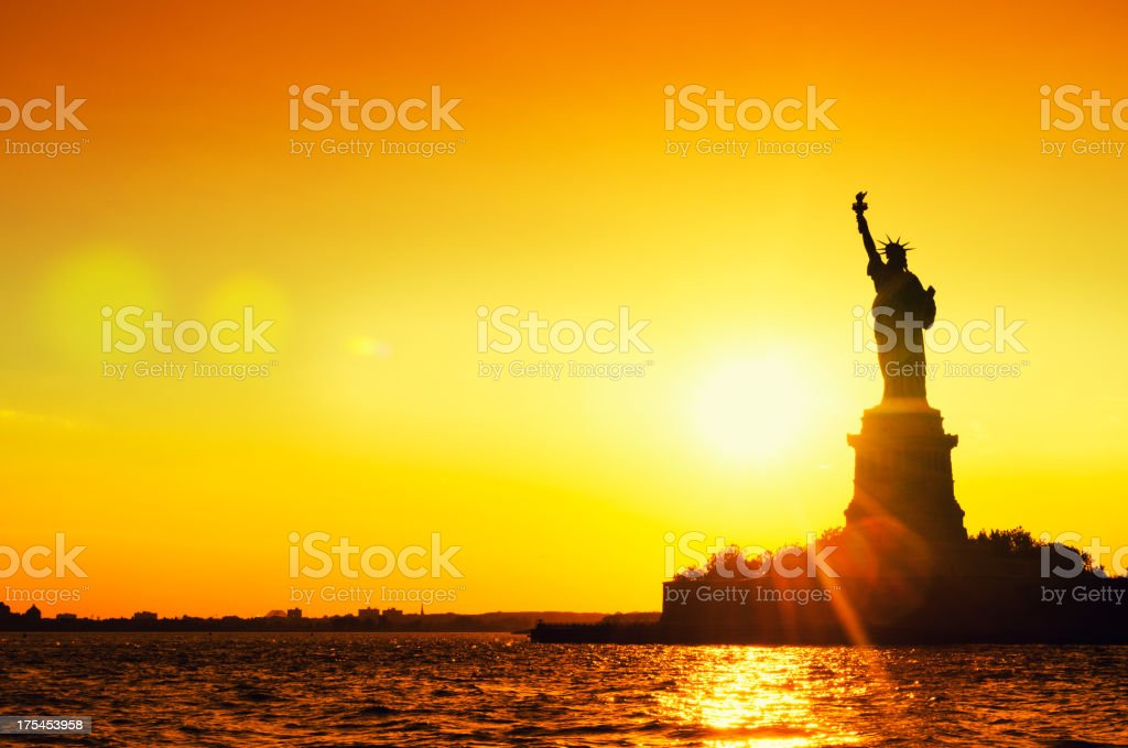 Statue of Liberty Silhouetted at dusk - New York City royalty-free stock photo