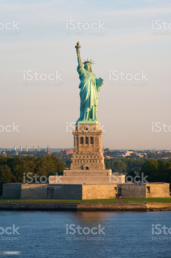 Statue of Liberty standing in the sunset stock photo